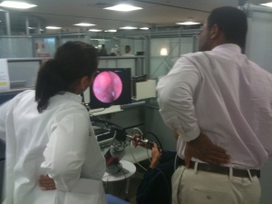 Residents from MWHC and MGUH watch as a colleague practices hysteroscopy skills